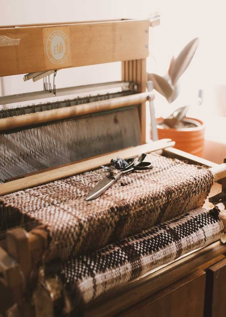 A loom used to hand-weave textiles for Leandi's designs.
